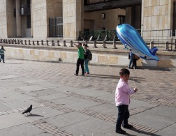 In the main plaza, kids everywhere on a Saturday, with their balloons