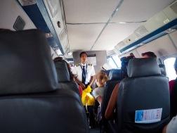 Captain giving us the safety briefing, en espanol.